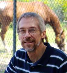 Dr. Allred poses for picture in front of horse