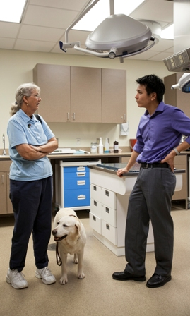 Kathleen Hornsby is shown with Mica and Dr. Stan Kim.